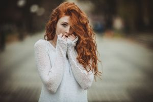 face women urban redhead curly hair freckles model women outdoors long hair white sweater looking at viewer hair in face