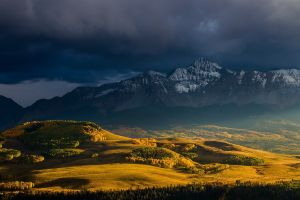fall storm warm colors overcast landscape valley nature sunlight mountains
