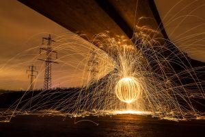 fire depth of field utility pole photography long exposure bridge sepia motion blur power lines circle