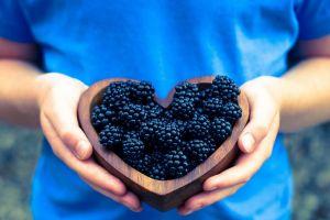 food blue fruit people hands blackberries