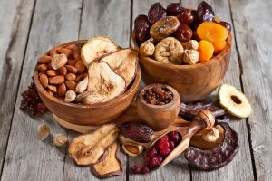 food wooden surface nuts fruit