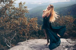 forest nature fall trees rock leaves dress model blonde windy women barefoot closed eyes long hair bare shoulders