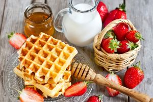 fruit milk waffles breakfast food strawberries wooden surface honey colorful