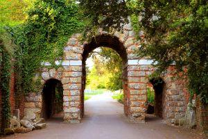 gates arch park green facade bricks