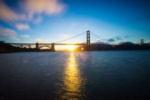 golden gate bridge lens flare bridge sunlight river silhouette san francisco