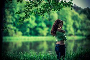 grass trees depth of field women outdoors nature branch open mouth jeans brunette bare shoulders women green