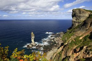 green cliff mountains forest water hokkaido prefecture japan sea landscape clouds nature