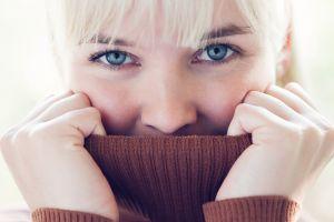 hands bangs sweater face blue eyes eyes blonde women