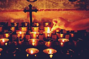 hands cross candles lights christianity