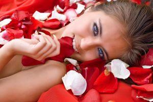 hands flower petals red long hair petals model lying on back brunette blue eyes biting flowers women looking at viewer face