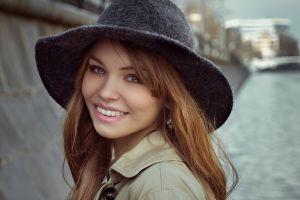 hat millinery anastasia scheglova portrait open mouth smiling trench coat model women face