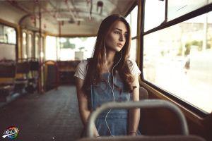 headphones sitting buses looking away women