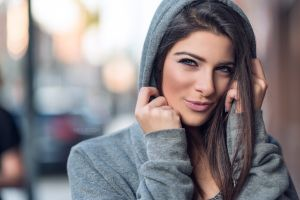 hood face brunette portrait blue eyes women nick pecori depth of field smirk