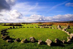 horizon landscape ireland sky clouds ancient stones trees grass rock
