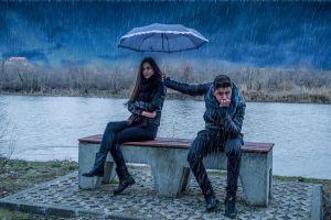 humor rain river men women umbrella bench sitting leather jackets