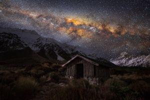 hut stars grass starry night space milky way universe nature snowy peak new zealand mountains landscape