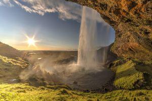 iceland landscape sun outdoors waterfall water sky rock nature seljalandsfoss waterfall