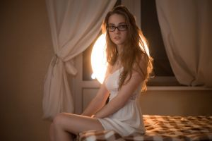 in bed white dress women with glasses open mouth women sitting brunette