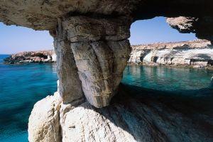 island beach cliff rock cyprus cave landscape nature sea