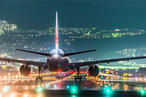 japan wings passenger aircraft rear view runway lights turbine osaka hills landscape airport night cityscape