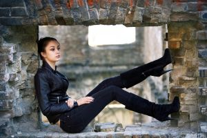 knee-high boots leather jackets women women outdoors jeans black jackets black boots sitting brown eyes black nails side view looking into the distance hands on legs brunette