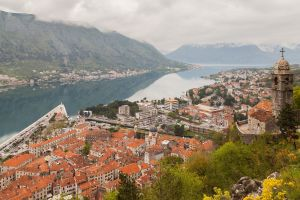 kotor (town) architecture hills europe clouds mountains montenegro church city building reflection old building river cityscape