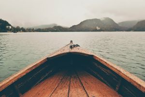 lake bled lake water mist water drops depth of field slovenia filter boat landscape