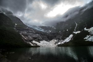 lake dark glaciers creeks norway clouds nature landscape mountains
