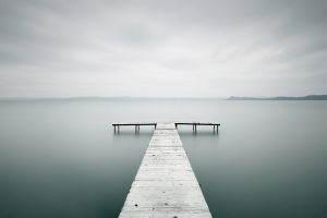 lake landscape horizon bright water sticks blurred nature clouds wood photography long exposure pier sea wooden surface