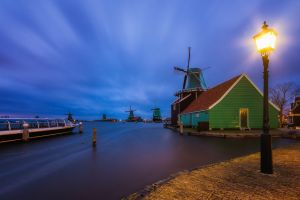 lamp lights clouds windmill long exposure town landscape water evening boat nature netherlands street light house