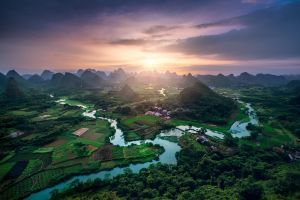 landscape clouds river valley field forest china nature hills green town sunset
