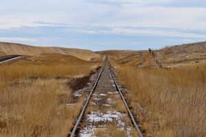 landscape fence sky brown hills field grass wasteland railway snow