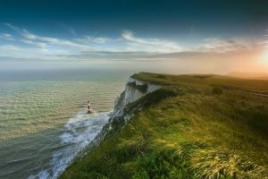 landscape grass mist sea nature cliff morning lighthouse clouds