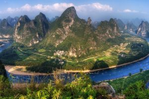 landscape shrubs clouds field china mountains sunset boat blue river water road nature panoramas green