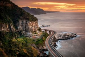 landscape sunset highway shrubs nature sea mountains clouds coast cliff