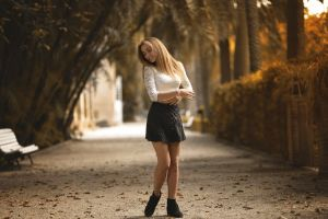 leaves women depth of field park smiling nature trees street fall skirt black skirts white tops model blonde path