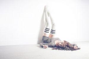 legs up brunette women thigh-highs lying on back minidress stockings long hair