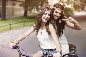 lesbians brunette women outdoors tongue out jean shorts flower in hair women headband model