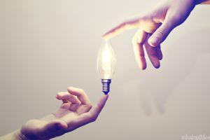 light bulb lights hands