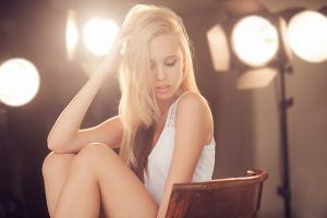 lights closed eyes blonde hair   chair women model long hair fahrbar+ face white dress