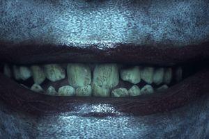 lips smiling teeth batman joker