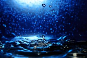 liquid water drops blue background water rain