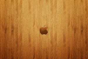 logo apple inc. wooden surface