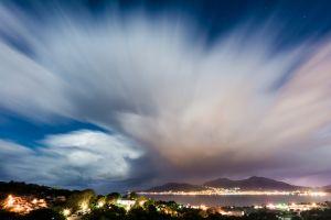 long exposure city lights landscape mountains clouds