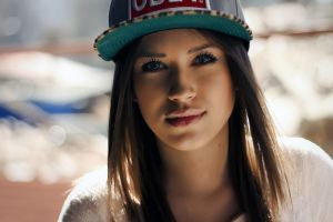 looking at viewer depth of field juicy lips brunette face women blue eyes baseball caps