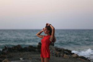 looking away sea model women red dress