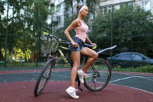 looking away women shoes bicycle jean shorts