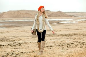 looking into the distance blonde looking away handbags women outdoors knee-high boots straight hair leather boots jacket long hair