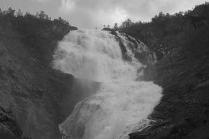 low saturation waterfall monochrome clouds rocks