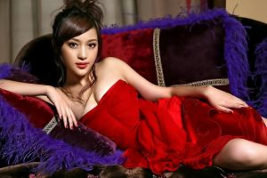 lying on side painted nails asian red dress makeup women brunette